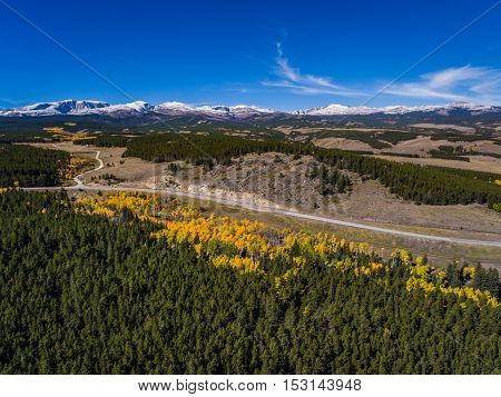 A mountain road moves through the Bighorn Mountains in Wyoming.