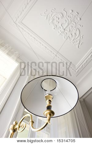 part of floor lamp from below and ceiling