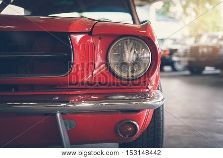 Close up headlight of red Retro classic car Vintage tone