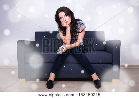 Winter Boredom - Young Bored Woman Sitting On Sofa And Watching Tv