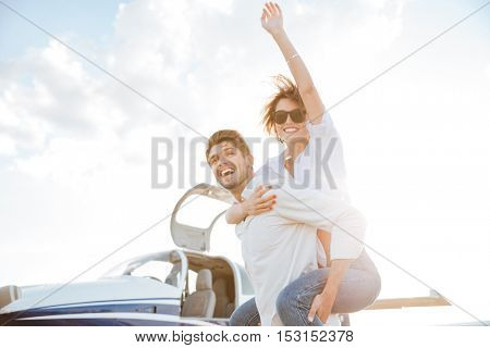 Happy young couple having fun on runway in airport