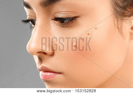 Skin Tone Cream. Model Face Of Beautiful Woman With Foundation On Skin Make-up Cosmetics
