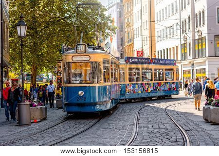 Munich, Germany - July 03, 2016: Old tram on the central street in Munich, Germany. This type of tram was produced from the 1950s