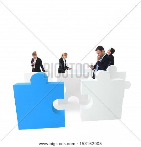 Group of business people with cell phones and puzzle pieces isolated on white backgrund