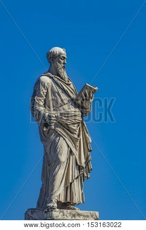 Saint Peter statue with key book and papal coat of arms from Sant Angelo bridge in Rome, Italy