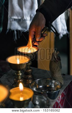 Preparations for morning prayer in Korzok monastery in Ladakh, India. Korzok is a Tibetan Buddhist monastery located in the Korzok village, on the northwestern bank of Tso Moriri lake