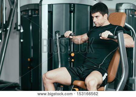 Gym Workout - Male Athlete On Chest Press
