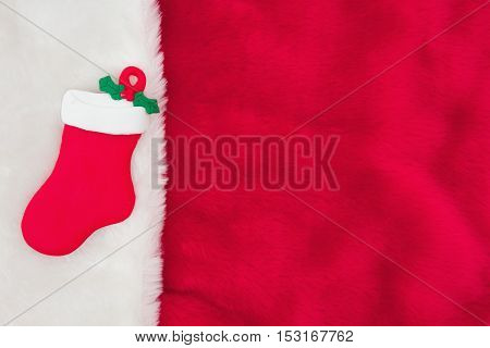 Christmas Time Background Red and White Plush Fabric with a Christmas Stocking Background with copy-space for your message