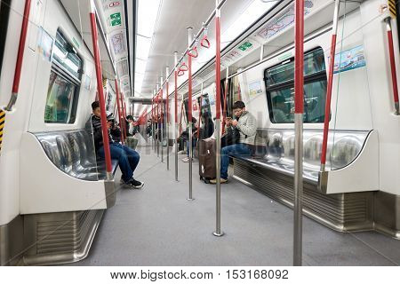 HONG KONG - CIRCA JANUARY, 2016: inside a MTR train. The Mass Transit Railway is the rapid transit railway system in Hong Kong. It is one of the most profitable systems in the world
