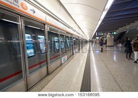 HONG KONG - CIRCA JANUARY, 2016: inside MTR station in Hong Kong. MTR is the rapid transit railway system in Hong Kong. It is one of the most profitable systems in the world