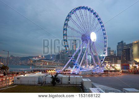HONG KONG - CIRCA JANUARY, 2016: Ferris Wheel in Hong Kong at twilight. The Hong Kong Observation Wheel is located in Central, Hong Kong.