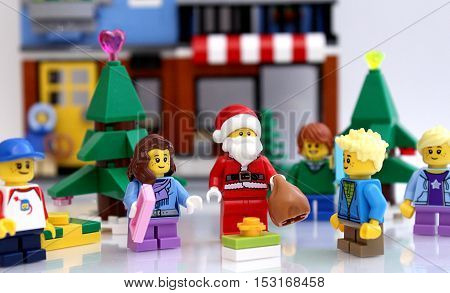 Castle Rock, Colorado, USA - October 24, 2016: Studio shot of LEGO minifigure Santa Claus with children in Christmas scene.