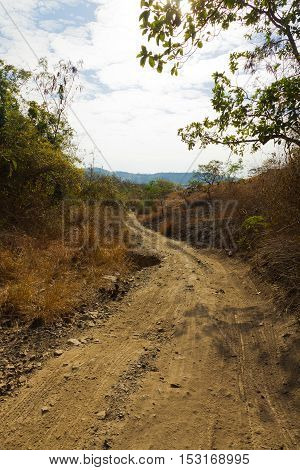Damaged asphalt pavement road with potholes , Asia