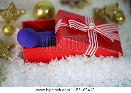 Dildo as a Christmas present, with Christmas tree balls and snow