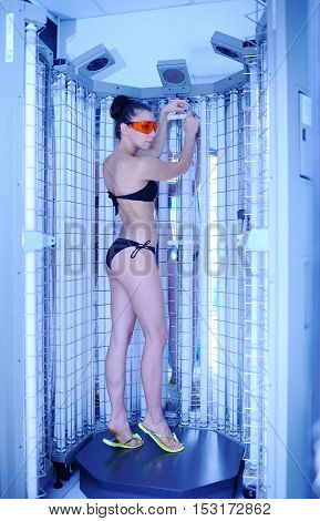 pretty girl on the background of the device for the treatment of light. phototherapy