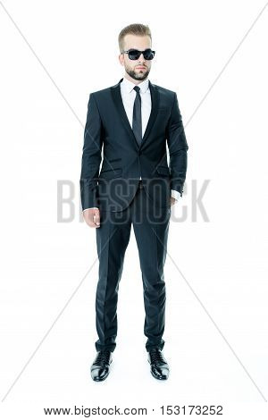 Handsome bearded man wearing suit, portrait shot in studio