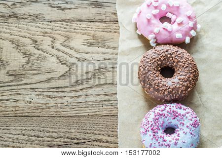 Colourful donuts arranged in a row: top view