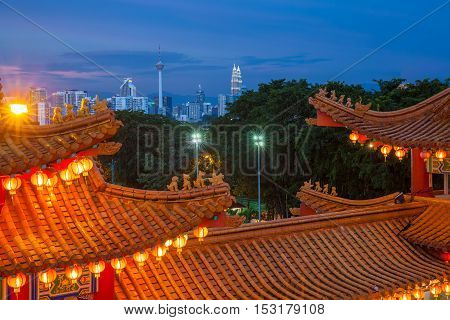 Kuala Lumpur Malaysia - September 15 2016: Dusk view of Kuala Lumpur skyline as seen from Thean Hou Temple illuminated for the Mid-Autumn festival on September 15 2016 in Kuala Lumpur Malaysia.