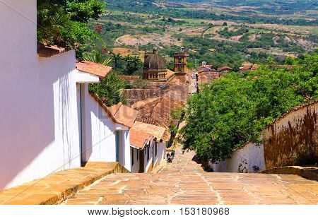 View of the town of Barichara with the cathedral visible at the bottom of the hill in Colombia