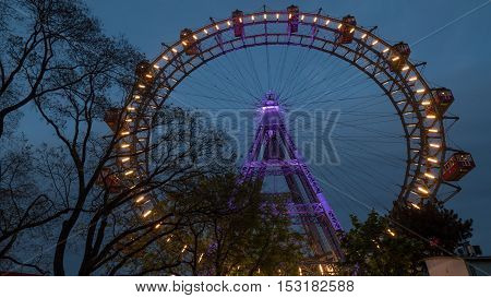 Low angle shot of illuminated Giant Ferris Wheel in Vienna, Austria. Observing the city from the height