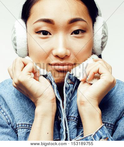 young pretty asian modern fashion hister woman in winter earphones posing cheerful emotional isolated on white background, lifestyle people concept close up