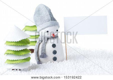 Cute festive snowman with sign isolated on white background