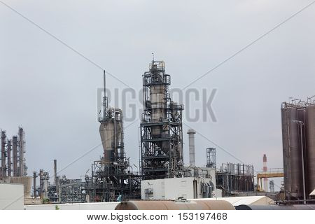 Industrial site of the chemical industry. Concrete factory or cement heavy industry manufacturing.
