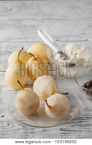 Whole Fresh Pears Called Birne Helene With Chocolate Sauce And Ice-cream As A Side Dish Served For A