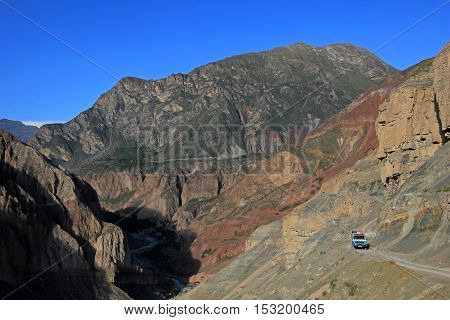 Cotahuasi Canyon Peru, van on road in canyon, one of the deepest and most beautiful canyons in the world