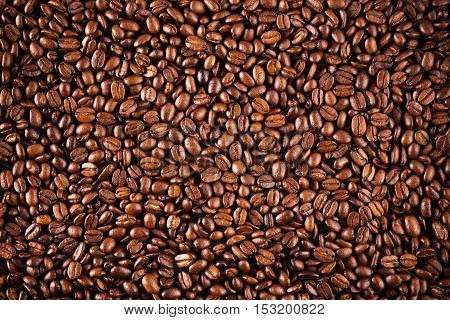 Coffee beans texture closeup. Brown coffee, background texture, closeup. Nice background for your ideas.