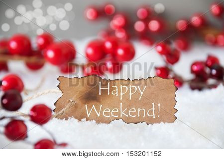 Burnt Label With English Text Happy Weekend. Red Christmas Decoration On Snow. Cement Wall As Background With Bokeh Effect. Card For Seasons Greetings
