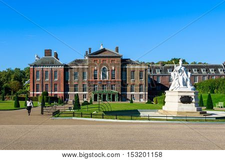 London, UK - September 30, 2016 - Queen Victoria statue and Kensington Palace in Hyde Park