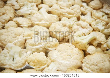 Macro closeup of white vegetables: cut cauliflower. Cauliflower texture closeup for any ideas. Fresh vegetables concept.