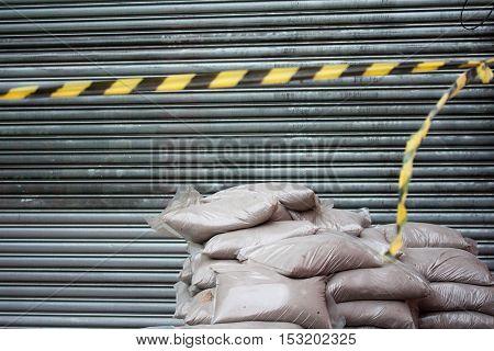 Pile of construction sandbags in front of roller door