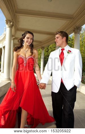 High School Students Going to the Prom.  Outside Photos of an attractive young teenage couple walking and holding hands.