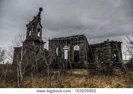 An old abandoned decayed wooden Church of the Intercession of the Holy Virgin in the village Aldia, Tambov region, Russia