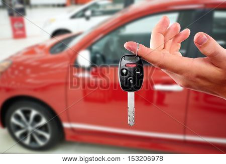 Dealer hand with a car key.