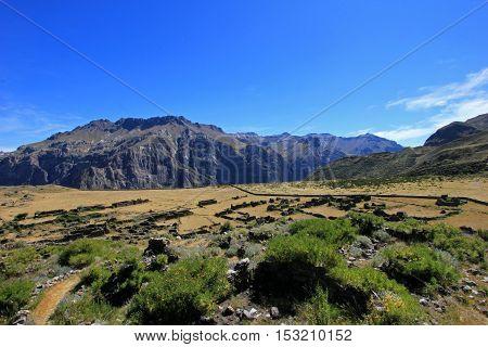 The pre-inca ruins of Maukallacta on the mountain over Puica a peruvian mountain village over the cliffs of the beautiful Cotahuasi Canyon