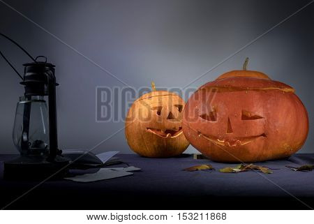 morning after Halloween. two pumpkins and a kerosene lamp