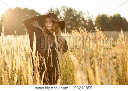 Beautiful Young Lady In A Brown Dress In A Field - Sunrise Shot
