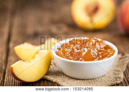 Wooden Table With Peach Jam