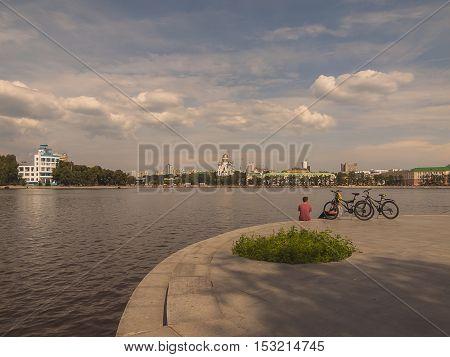 Embankment of the river Iset. Yekaterinburg city. Summer. Day. Cloudy. City landscape. Sverdlovsk region. Russia.