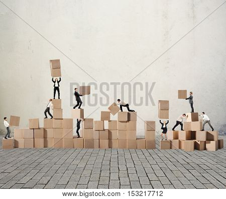 Business person built together a wood cubes construction