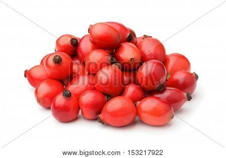 Pile of fresh rose hips isolated on white