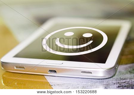The smiley face on the phone screen . The concept of good mood .