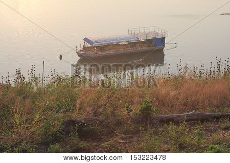 Boats moored in the river at dawn