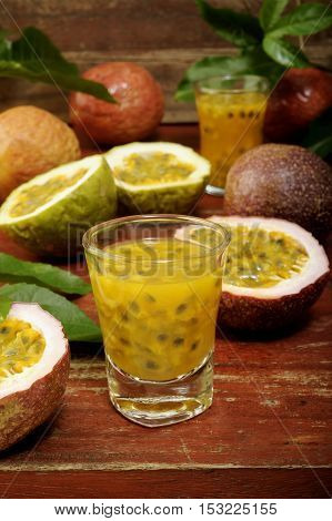 Passion fruits with leaves on wooden background