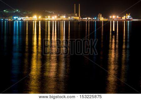 city reflection on night sea