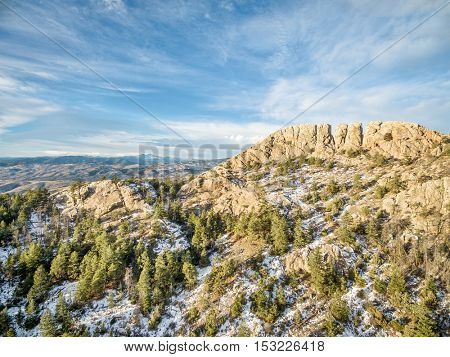 Horsetooth Rock, a landmark of Fort Collins, Colorado, winter scenery with some snow and Rocky Mountains in background
