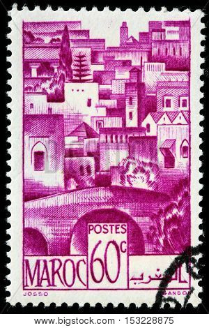 LUGA RUSSIA - JUNE 25 2016: A stamp printed by MOROCCO shows view of Bein Bridge and Mdoum circa 1947